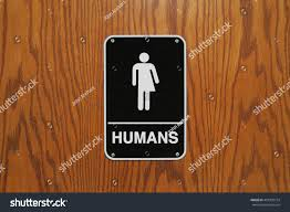 Gender Inclusive Bathroom Sign by Gender Neutral Restroom Sign With Stick Stock Photo 459390724