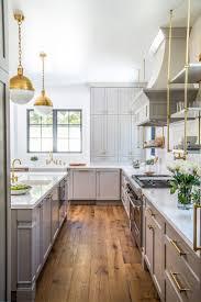 luxury vintage navy kitchen design with brass hardware countertops