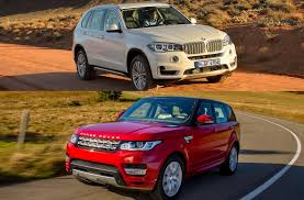 Car review 2014 BMW X5 versus Land Rover Sport in luxury SUV