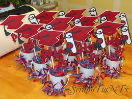 graduation centerpieces pails with cap and year decorations