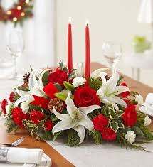 Flowers In The Signature Colors Of Season Accented With A Fragrant Mix Evergreens And Pinecones For Finishing Touch Red Velvet Ribbon