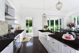 interior black quartz countertop kitchen with white wooden