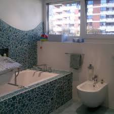 Huge Trendy Glass Sheet And Blue Tile Terrazzo Floor Powder Room Photo In