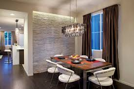 This Extravagant Dining Room Has A Striking Stacked Stone Accent Wall As One Of Its Many Design Elements The Contrasts With Polished Light