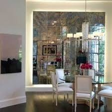 miami antique mirror tiles dining room transitional with tufted