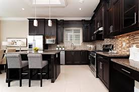 the expresso cabinets with the light tile floor