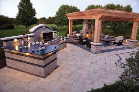 Amazing Outdoor Kitchen Using L Shaped Stone Cabinets With Black Granite Contertop