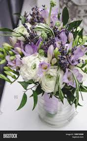 Modern Bride Bouquet Of Violet Freesia White Buttercup Ranunculus Peonies Green Leaf Lilac