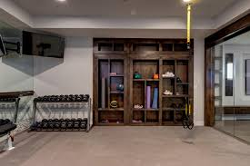 14 Smart Design Ideas For Underused Basements   HGTV's Decorating ... Basement Gym Ideas Home Interior Decor Design Unfinished Gyms Mediterrean Medium Best 25 Room Ideas On Pinterest Gym 10 That Will Inspire You To Sweat Window And Big Amazing Modern Center For Basement Gallery Collection In Flooring With Classic How Have A Haven Heartwork Organizing Tips Clever Uk S Also Affordable