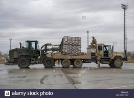 100 Truck Loads Available A Central Command Materiel Recovery Element Team Member Loads Cargo