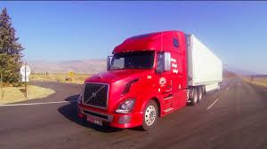 A Red 18 Wheeler Truck Moves Across The Desert In This POV Shot ...