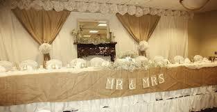 Rustic Head Table Decor Burlap On The Front Of Curtains Gathered And Tied Over White Curtain Panels Large Flowers Are Tissue