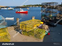 Decorative Lobster Traps Small colorful lobster traps align dock lobster stock photo 385914211