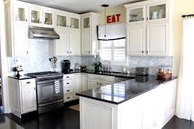 Antique White Painted Custom Kitchen Cabinet With Black Granite