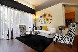 Small Living Room With 2 Zebra Print Armless Chairs One White Sofa Glass