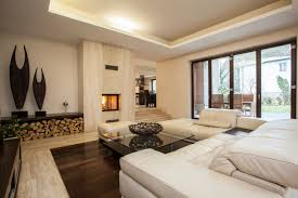 Elegant Contemporary Living Room With Dark Hard Wood Floor Over Stuffed White Furniture And