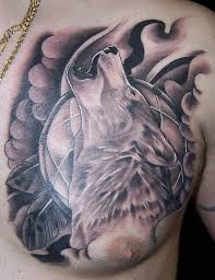 Black And Grey Howling Wolf Tattoo On Man Chest