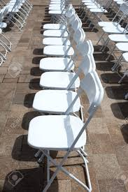 Rows Of Folding Chairs At Event