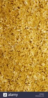 Yellow Carpet Of Artificial Material Close Up The Texture