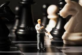 Download Miniature Teacher Explains Chess Game Rules On Board Strategy Analysis Concept Stock
