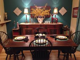 This Teal Accent Wall With Drapes Mixed Chocolate Wood Furniture Makes Dinner Room Very Cozy And Special