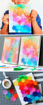 Try This Fun Art Project Idea For Kids Just Punch Shapes From Bleeding Tissue Paper Paint With Water And Reveal The Finished Canvas