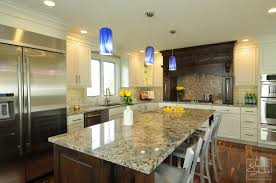Open Concept Big Rock Kitchen Remodeling With White Cabinetry And Dark Island