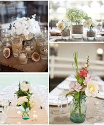Glass Jars And Wild Flowers Wedding Table Centrepieces