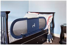 Toddler Bedroom With Black Furniture And Navy Bed Rail