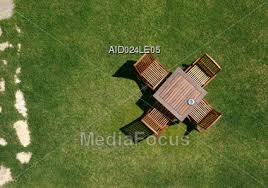 View From The Top Onto Garden Furniture On Green Lawn Stock Photo