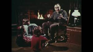 1970s: Man Sits In Rocking Chair In Front Of Fireplace, Talking To Three  Children Sitting On Floor. Three Children Sit Listening. Stock Video  Footage ... Rocking Chair On The Wooden Floor 3d Rendering Thonet Chair At Puckhaber Decorative Antiques Man Sitting Rocking In His Living Room Looking Through Costway Classic White Wooden Children Kids Slat Back Fniture Oak Creating A Childrens From An Old Highchair 6 Steps Asta Recline Comfy Recliner Mocka Au Happy Pregnancy Sitting On Stock Image Of Jackson Rocker Click Black New Price Vintage Hitchcock