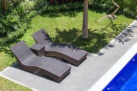 Two Beach Chairs Next To A Swimming Pool In Tropical Garden Top View