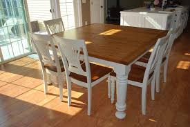 Easy DIY Modern Square Farmhouse Dining Table With Oak Top And Wooden Base Painted White Color For 8 Chairs Beside Glass Sliding Door Ideas