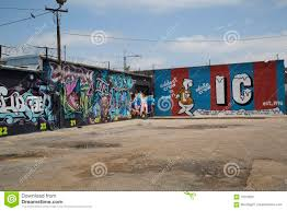 Deep Ellum Wall Murals by Colorful Graffiti On Brick Wall Of Buildings Editorial Photo