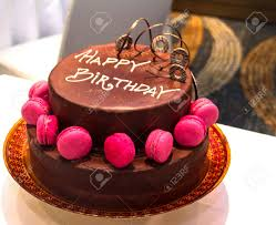 beautifully decorated a festive chocolate cake with the inscription Happy Birthday Stock