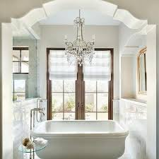 Chandelier Over Bathroom Vanity by Chandelier Above Bathtub Design Ideas