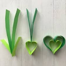 Arrange Three Completed Paper Strip Hearts On A Work Surface To Make Shamrock Staple The Pointed Heart Ends Together Bend Near