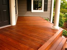 cedar deck stained with lovitt s emerald gold log home stain in