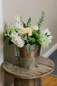 Rustic Flowers In A Tin Bucket