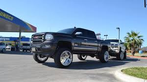 TWO SIK LIFTED TRUCKS On 9