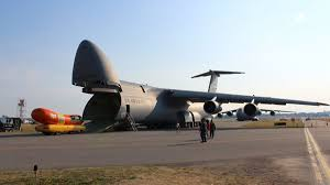 Let's Caption This Pic Of The Wienermobile Being Eaten By A C-5