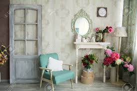 Vintage Country House Interior With Mirror And A Table Vase Flovers