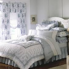 Grey And White Laura Ashley Bedding With Floral Motif On Brown Wooden Floor Matched