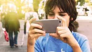 Tween Boy Using Smartphone