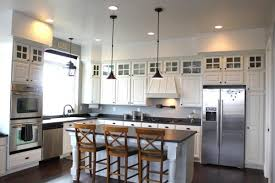 riveting soffit ideas above kitchen cabinets with pendant lighting