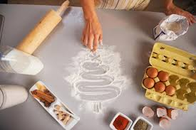 Download Closeup On Housewife Drawing Tree Kitchen Table With Flour Stock Photo