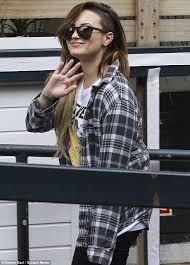 Demi Lovato arrives at ITV studios in grungy plaid shirt and boots