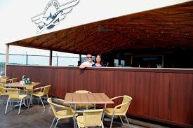fiorentino s unveils new outdoor bar patio next to the runway at