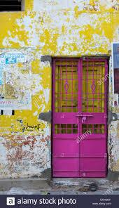 Pink metal security door in tatty indian house Andhra Pradesh