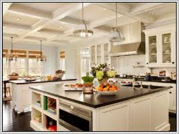 granite countertop kitchen island with sink and seating delta